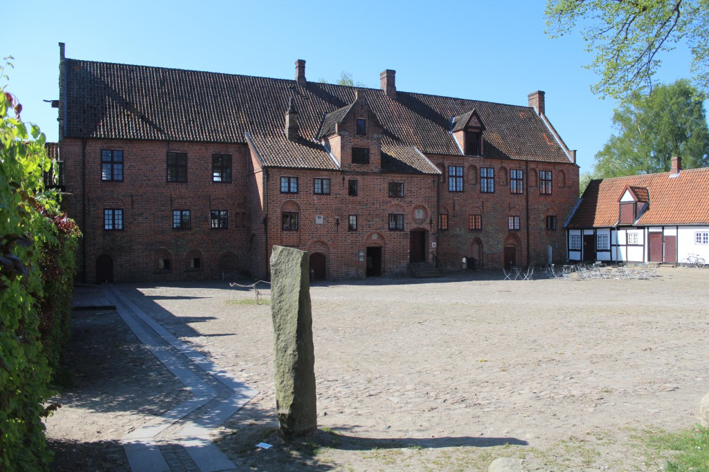 """Esrum Monastery. Økonimibygningen. At left a """"Kagsten"""" used to punish people after legal proceedings. Phptp in direction south 12. may 2016 by Erik K Abrahamsen."""