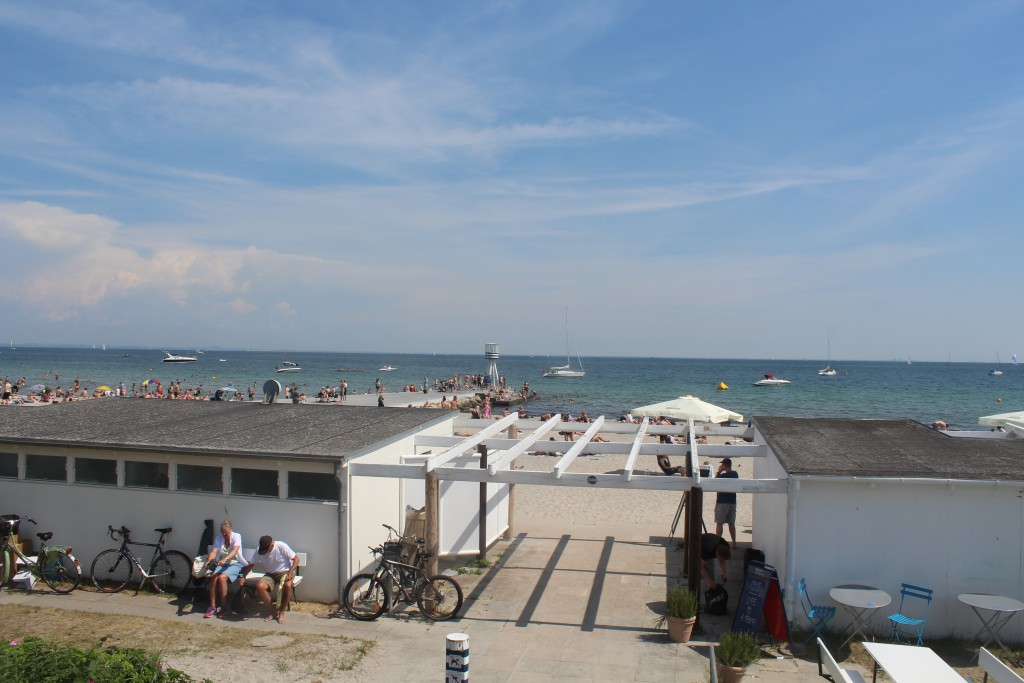 View to Bellavue Beach with original lifeguard towers, kiosk and sture buildings designed by architect Arne Jacobsen in 19