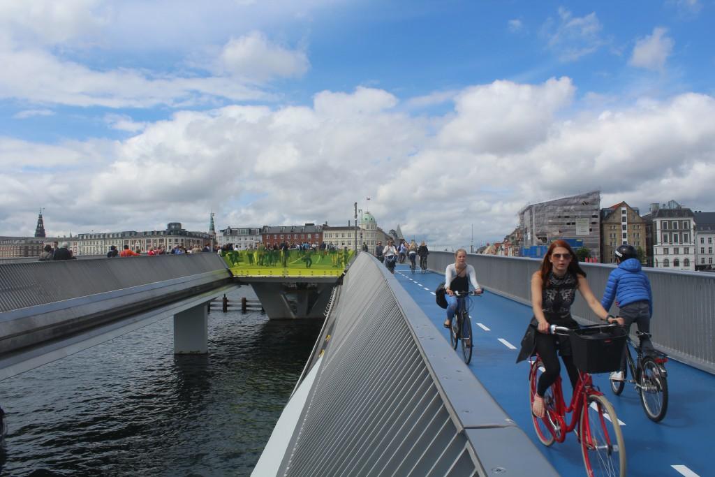 On top of walk-and bike bridge Inderhavnsbroen. Vie in direction north to Nyhavn and Copenhagen City