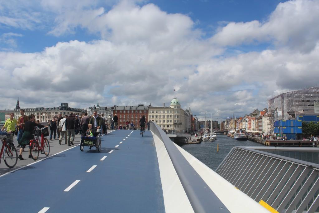 """View from top of new walk- and bike bridge """"Inderhavnsbroen"""" to Nyhavn and Copenhagen City"""