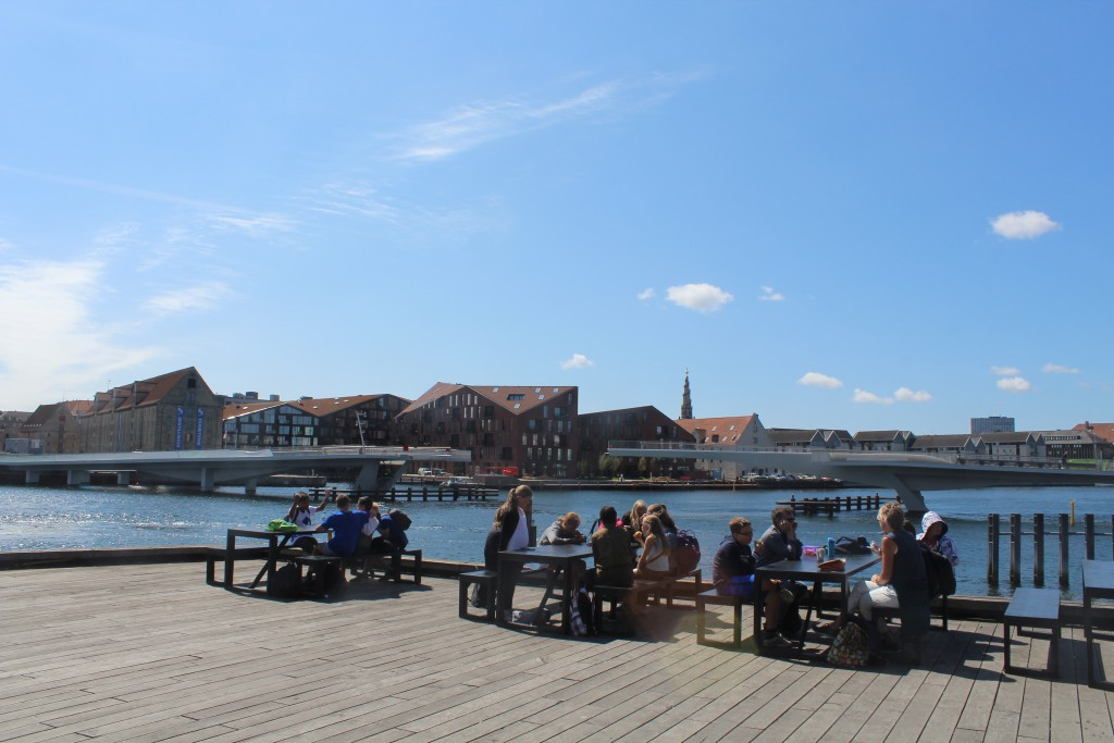 "Copenhagen Inner Harbour - relaxed atmosphere in from of New Copenhagen Opera built 2005. View to nes walk- and bike slide bridge ""Inderhavnsbroen"". Pg"