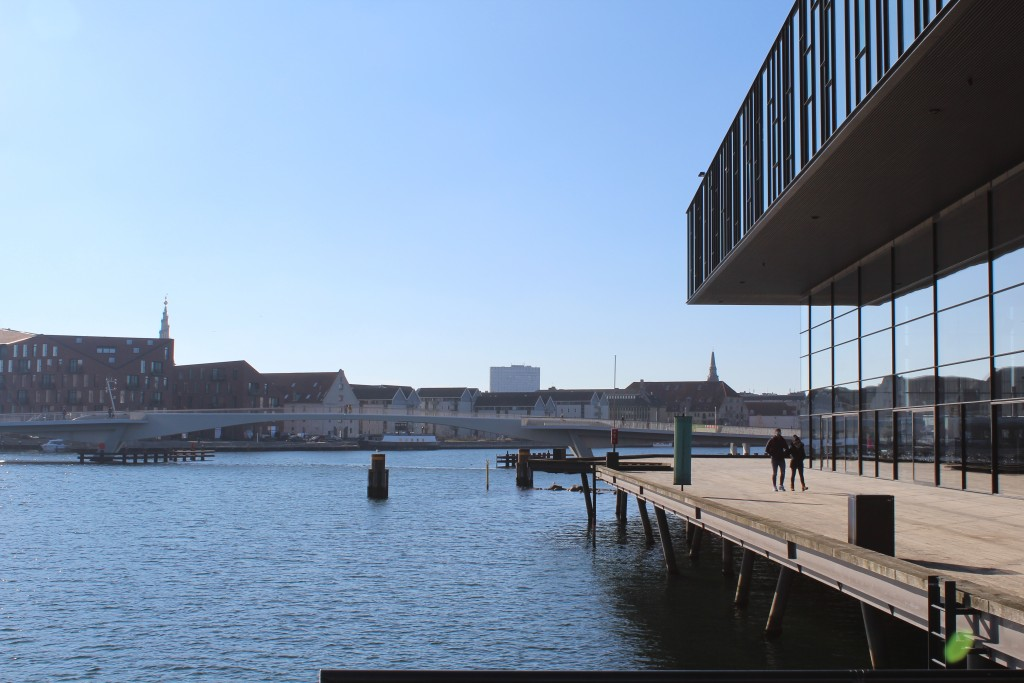"Copenhagen Inner Harbour. View to new walk- and bike slide bridge ""Inderhavnsbroen"" connecting Nyjavn and Christianshavn. At right new Royal Theatre built 2004-07. Phoot 22. february 2018 by erik K Abrahamsen."