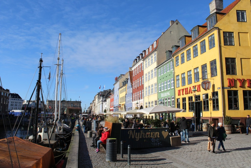 Nyhavn Sunny Side. View to safety concrete barracks as bench, flowers and climbing wall for children.