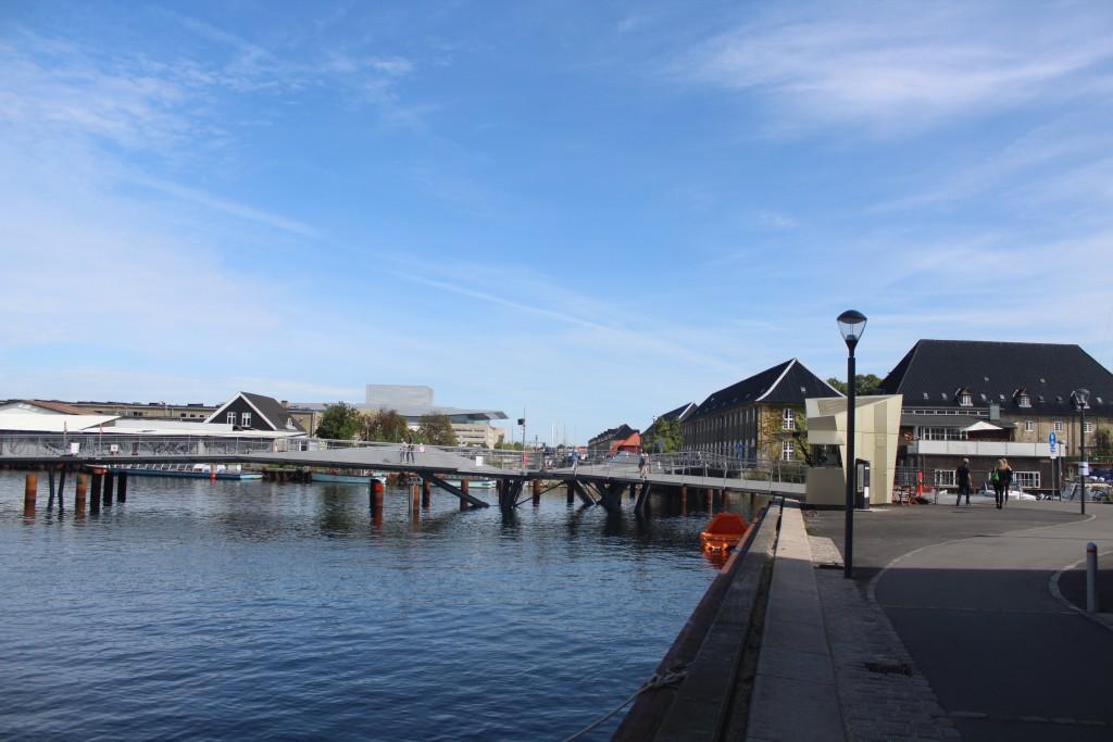 """Transgravsbroen - walk-and bike bridge between Holmen and Christianshavn. Copenhagen OPERA in the backgr"