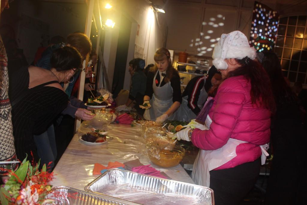 Volunteers serving the vegetarian christmas mesl.