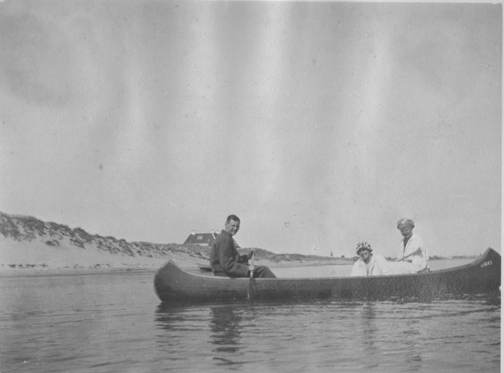 """The Royal Famile and friends in a canoe at Kattegat Coast with royal summer residens """"Klitgaarden"""" in the background. Phot from Laurits Tuxen private photo album 1902-27. Scanned february 2016."""