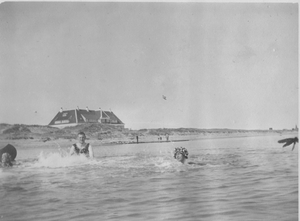 """The royal danish family with friend swimming in Kattegat Sea. In background on phot you can sea the royal families summer residence """"KLitgaarden"""", Skagen ."""