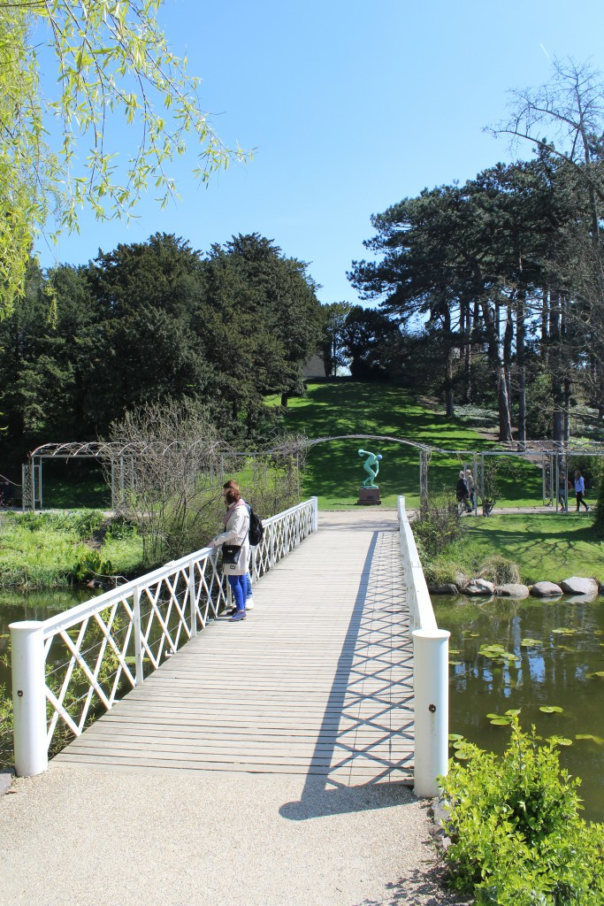 View to white bridge and statue
