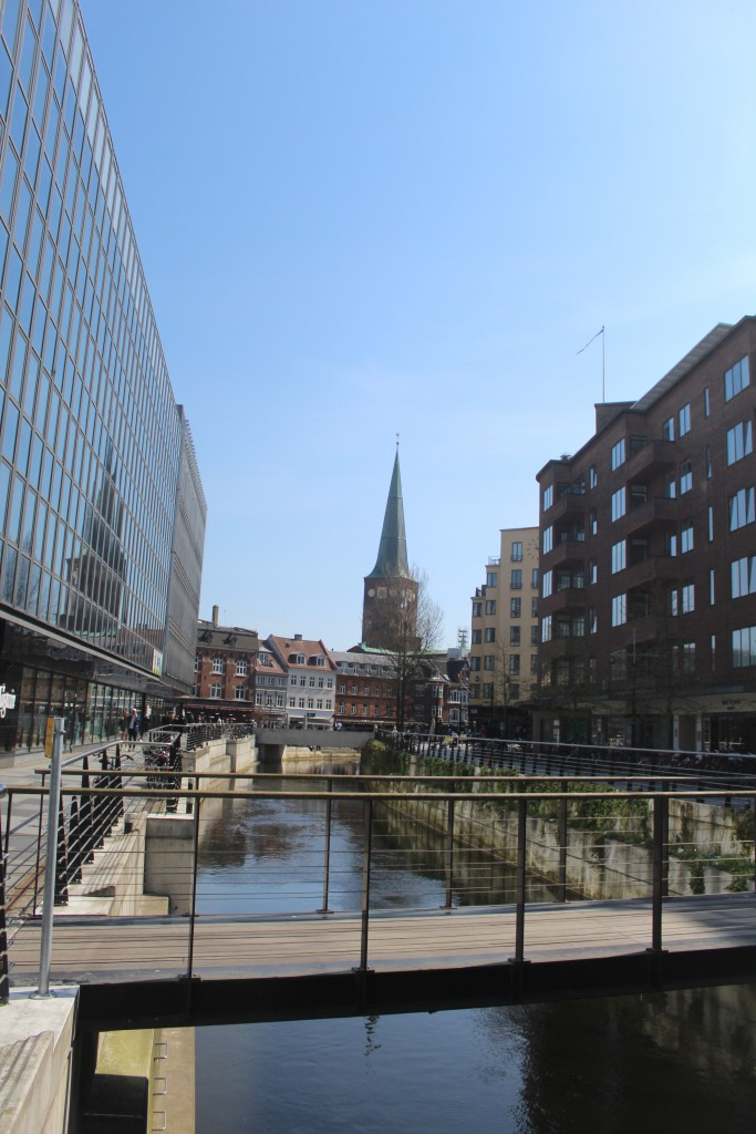 "Aarhus River. View in direction east to ""Vadestedet"" and 93 m high tower of Aarhus Cath"
