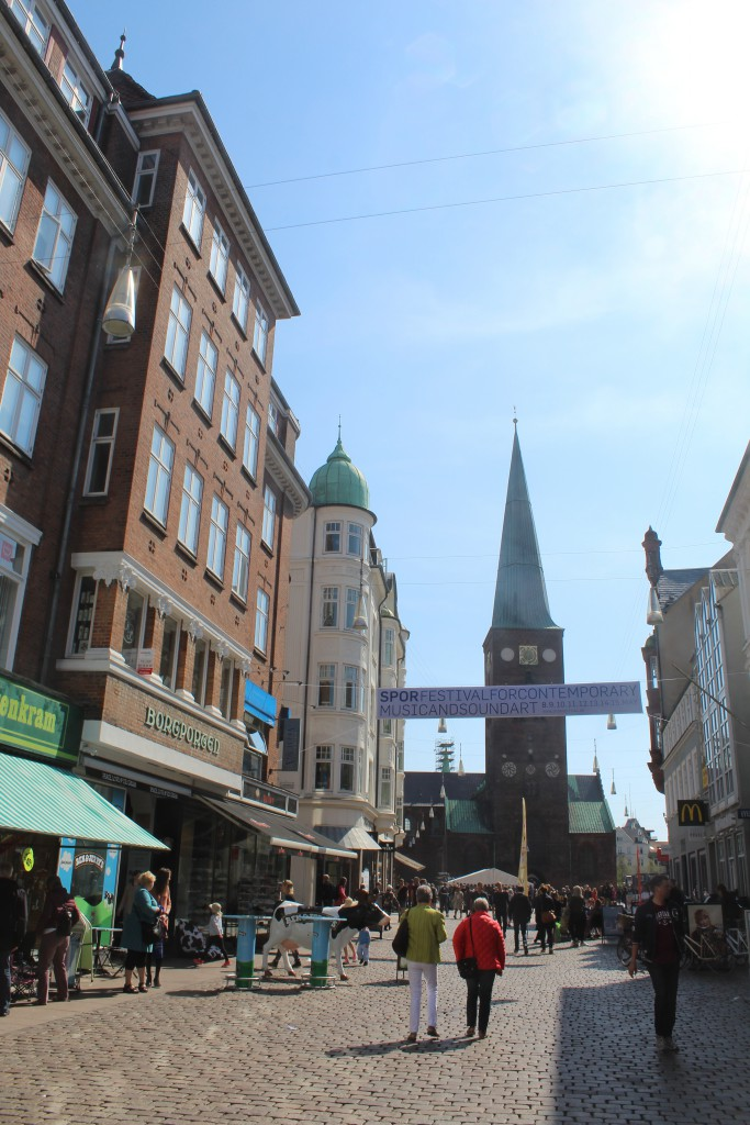 "Store Torv with Borgporteb at left - the entrance to old city of Aarhus. Photo in direction to Aahus Cathedral ""Domkirken"". Photo 7. may 2016 by"