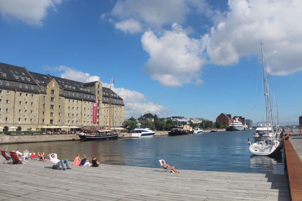 Ofelia Place on Quay Kvæsthusbroen, Copenhagen Inner Harbour. View to Admiral Hotel, former stier House built 1770, Amaliehaven and 2 more store houses built 1770-80. Photo 20. july 2016