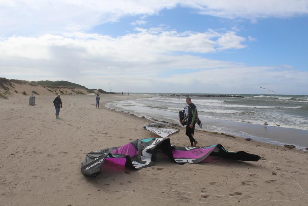 Liseleje beach. A kitesurfer takes a break on the beach before he change his sail to a small sa