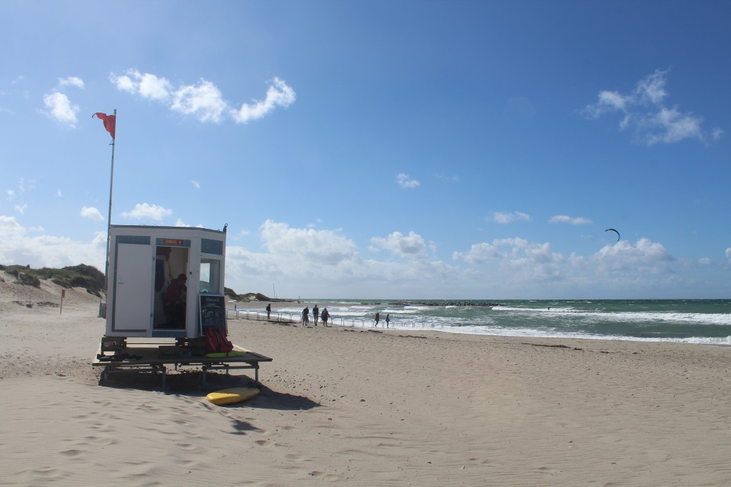 """Liseleje Beach. View in direction west to Life rescue Post, Handicap Bridge and """"Pynten"""" with Breakwater built 1911"""
