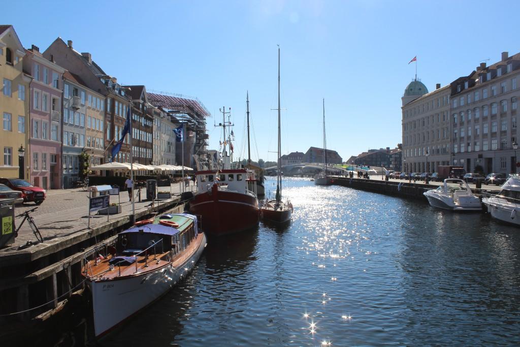"""Nyhavn. View in direction south to bike-, run and walk bridge """"Inderhavnsbroen"""" in Copenhagen Inner Harbour"""