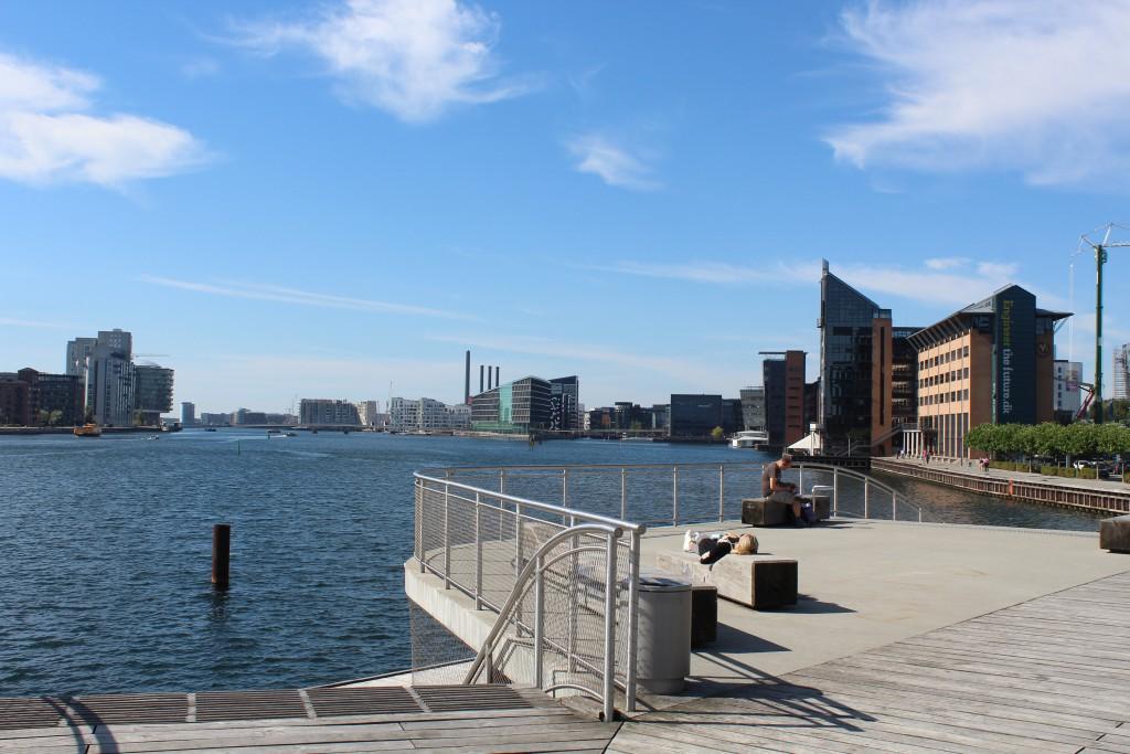 """View from """"Kalvebod Wave"""" to bike-walk and run bridge Q""""Bryggebroen"""" passing Copenhagen Inner harbour between"""