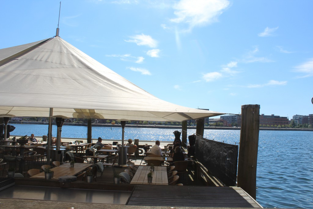 Outdood restaurant floating in Copenhagen Inner harbour at lkalvebod brygge. Photo in direction sout to islands bryfg