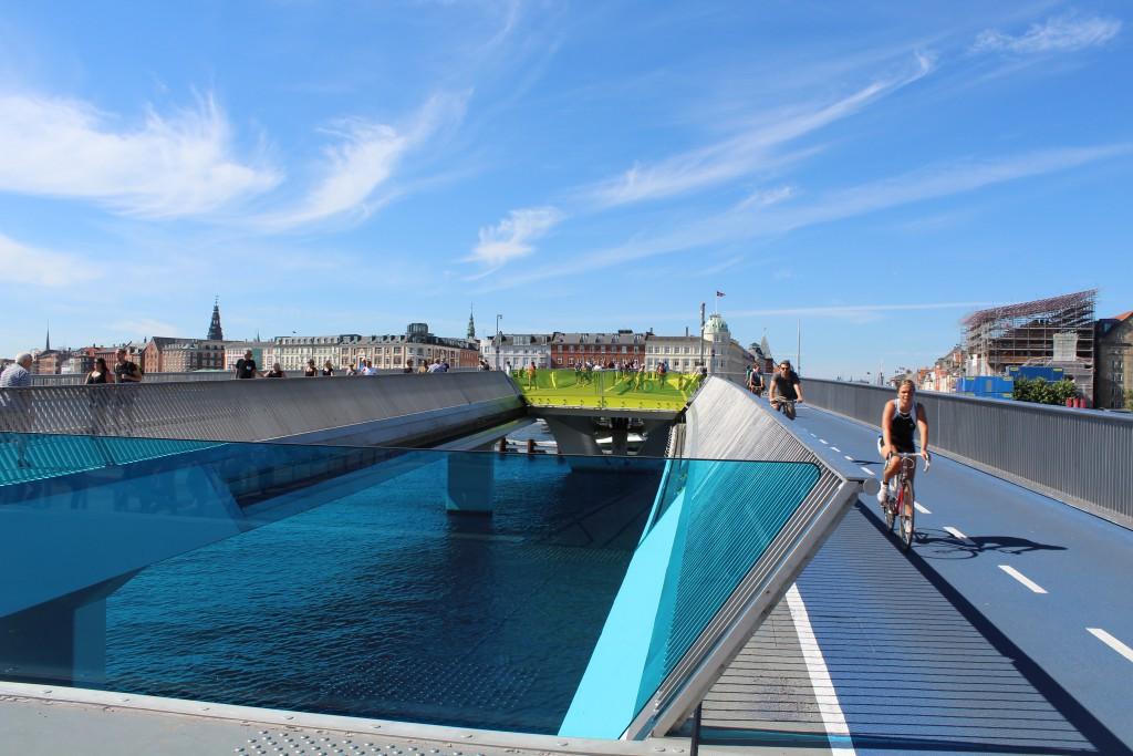 Inderhavnsbroen - new bike-, walk and run slide bridge passing Copenhagen Inner harbour between Nyhavn/Havnegade go Grø