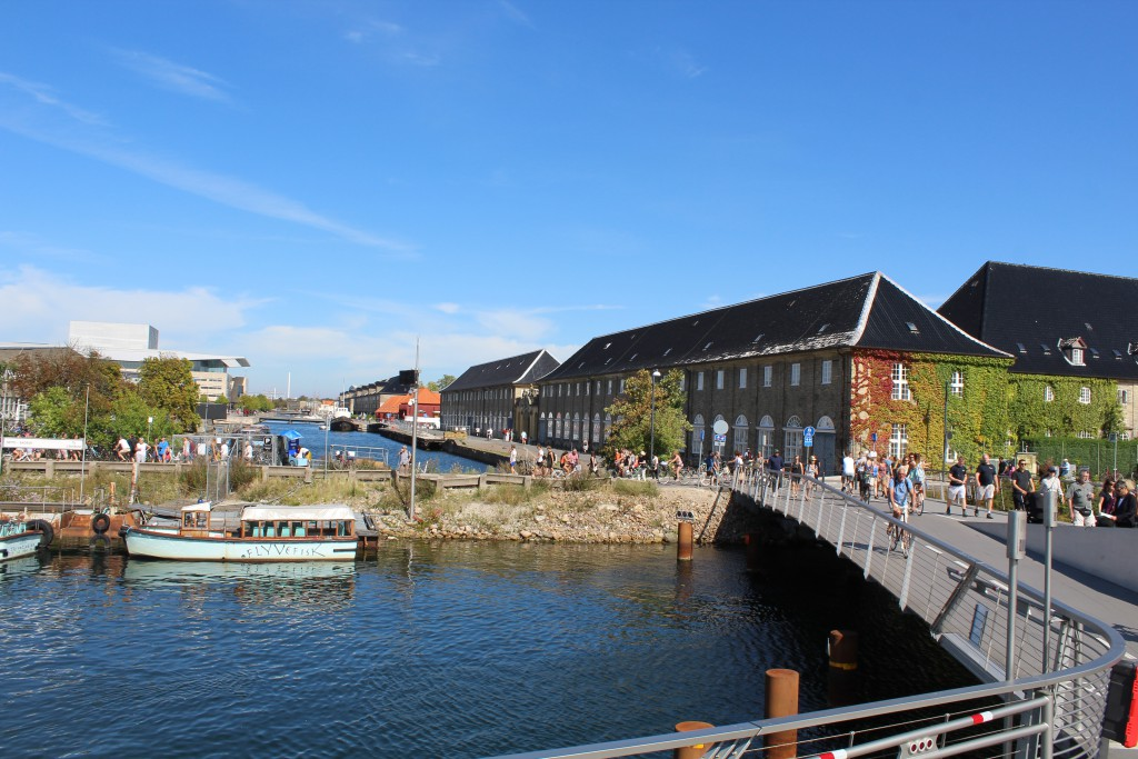 View to Holmen with Island Arsenaløen at right and island Christianshaolm at left and new bike-, walk and run bridge in middle of photo. Proviantbroen passing Provienat Canal between Arsenaløen and island frederiksholm on Holmen.