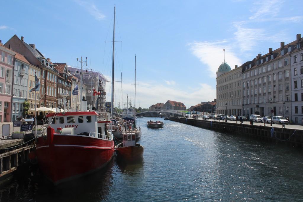 "Nyhavn Canal - view in direction south to Copenhagen Inner Harbour with new walk-and bike slide bridge ""Inderhavnsbroen"" connecting Nyhavn with Christianshavn. Photo 6. june 2016 by Erik K Abrahamsen."