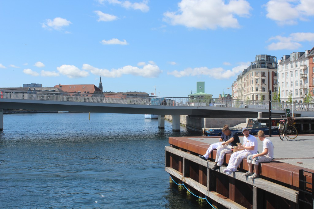 Copenhagen Inner Harbour. Relaxed atmosphere at lunch time on bulwark at NYhavn Canal. Photo 6. june 2016 by Erik K Abrahamsen.