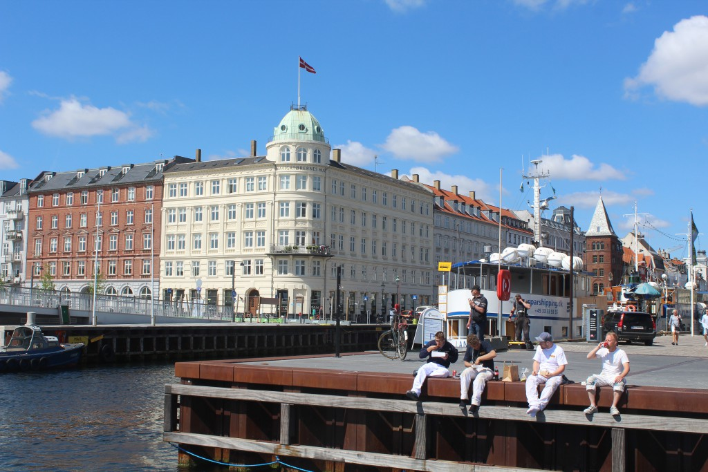 Copenhagen Inner Harbour. Relaxed lunch time atmosphere at bulwark at Nyhavn Canal. Photo 6. june 2016 by Erik K Abrahamsen.