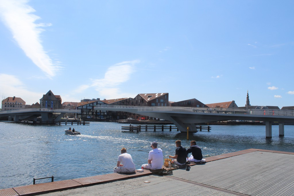 Summer in Copenhagen City. Lunch on bulk if Copenhagen Inner Harbour. View to new wal