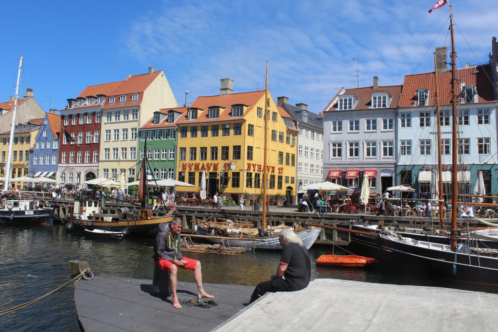 """Nyhavn canal, Relaxatin on a boat in the canal. Photo in direction to """"Sunny Side """" of Nyhavn midday 6. june 2016 by Erik K Abrahamsen."""