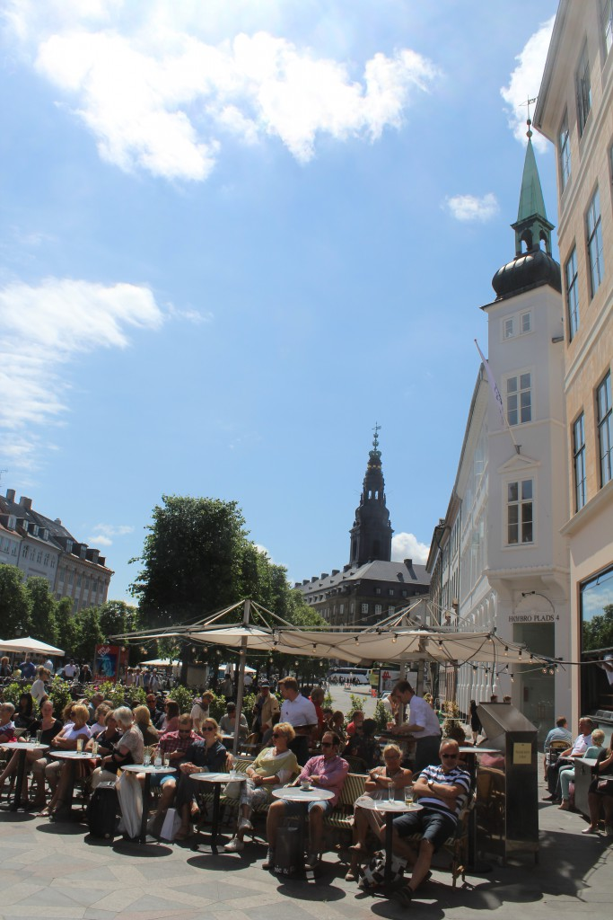 Amager Square - lunch on restaurants. View in direction to Christiansborg Castle builded 1906-26: The Danish parliament, High Court and Government administration