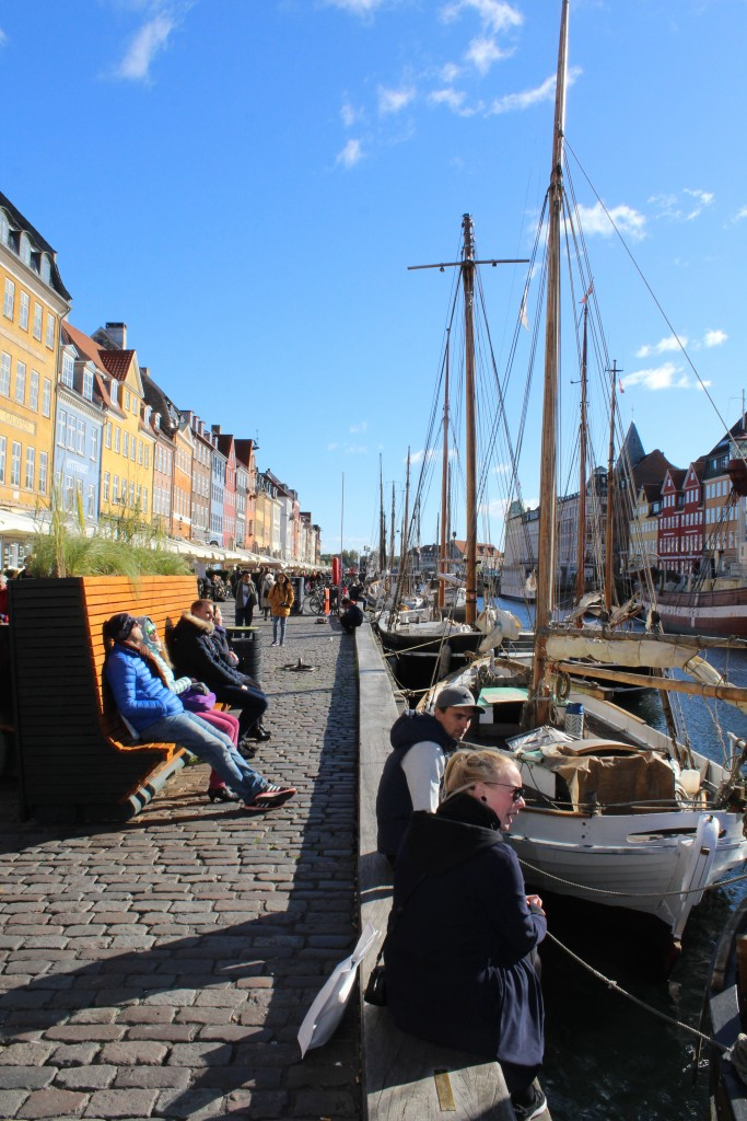 Nyhavn. Concrete barrier covered with a ply for children, flowers and a bench. Photo in direction south 9. october 2017 by Erik k Abrahamsen.