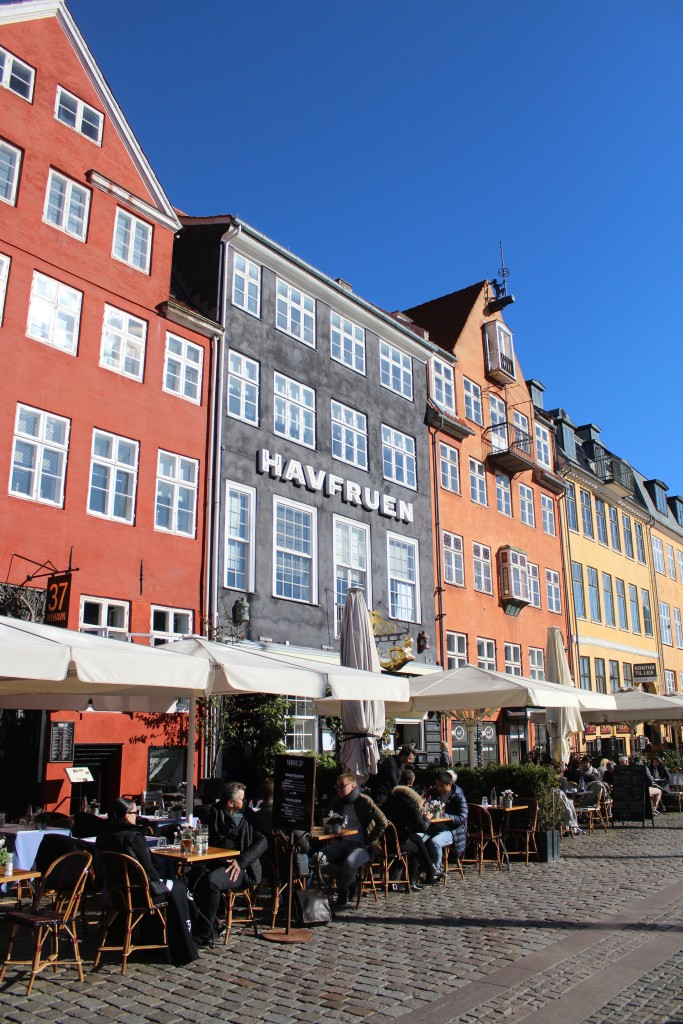 "Nyhavn ""sunny side"" - outdoor restaurants close to wharfs of the canal."