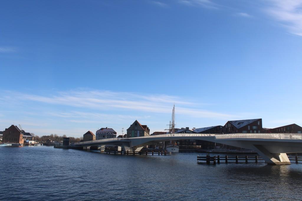 Copenhagen Inner harbour. View in direction west to new 180 m long bike- and walk bridge Inderhavnsbroen between Nyhavn and Nordatlantens Brygge on Christianshavn. Photo 5. february 2018 by Erik K Abrahamsen.