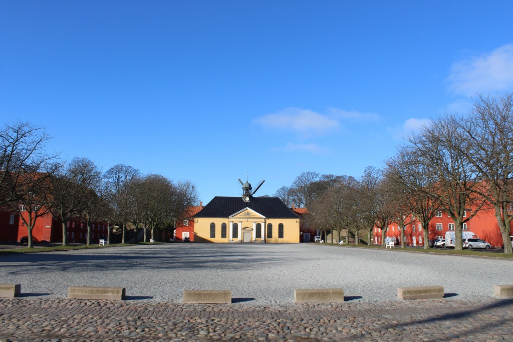 Fortress Kastellet. View to drill ground, Kastlekirken built 1703, prison behind the church built 1725 and Holland Windmill on top of Kinga Bastion. Photo 22. february 2018 by Erik K Abrahamsen.