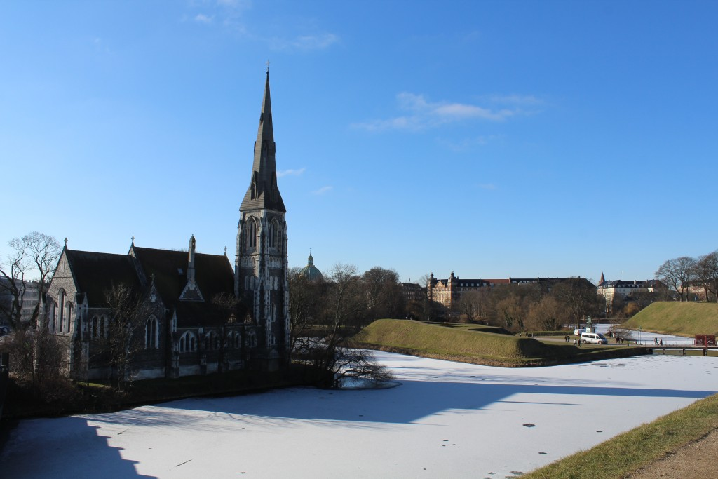 View from top of Count Bastion to Sct. Alban Church buili 1882, ramparts, moats and entrance bridges to south side of Fortress Kastellet. Phoot 22. februar 2018 by Erik K Abrahamsen.