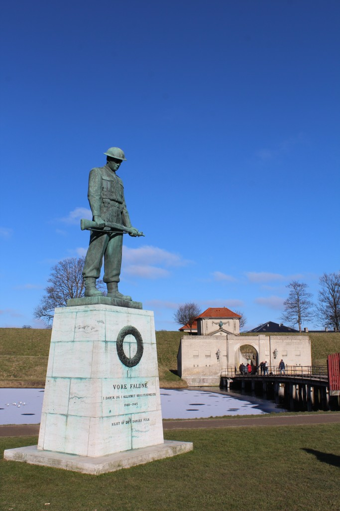 """Fortress Kastellet. Monument of danes died under German occupation of Denmark under 2. World War 1940-45. View to ravelin with bridges to entrance Kings Gate """"Kongeporten"""", ramparts and moats. Photo 22. february 2018 by Erik K Abrahamsen."""