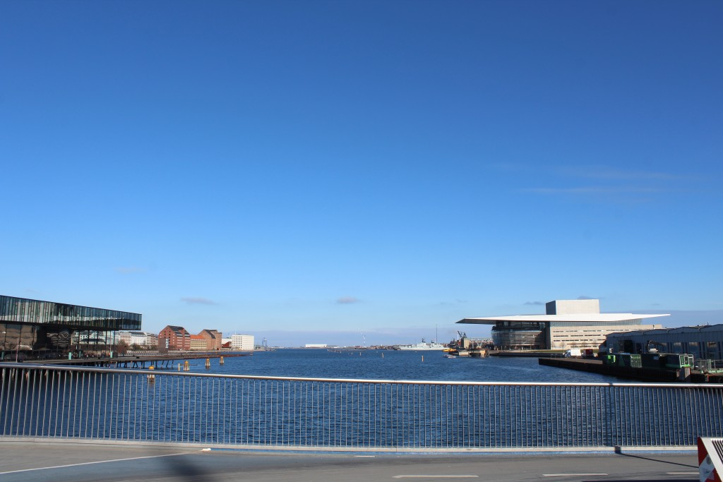 Copenhagen Inner Harbour. View from new 180 m long walk-and bike slide bridge to at left New Royal Theatre built 2004-07, 3 store houses built 1790-1800, Naval Base Holmen 1680-1989 with Wuseumship Herluf Trolle built 1965, Masetkranen built 1751, Naval Shipyard 1927-89, New Dock with Pump House built 1858 and New Copenhagen Opera built 2002-04.