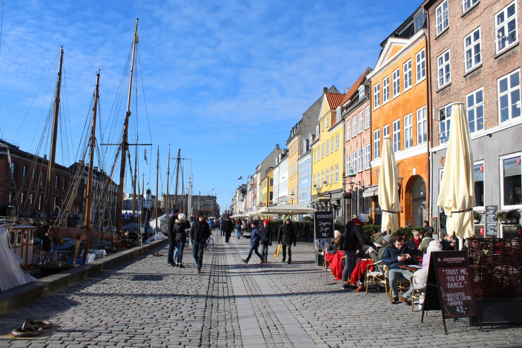 """Nyhavn """"Sunny Side"""". View to old store houses for trade close to wharf of canal. Photo in direction north 22. february 2018 by erik K Abrahamsen."""