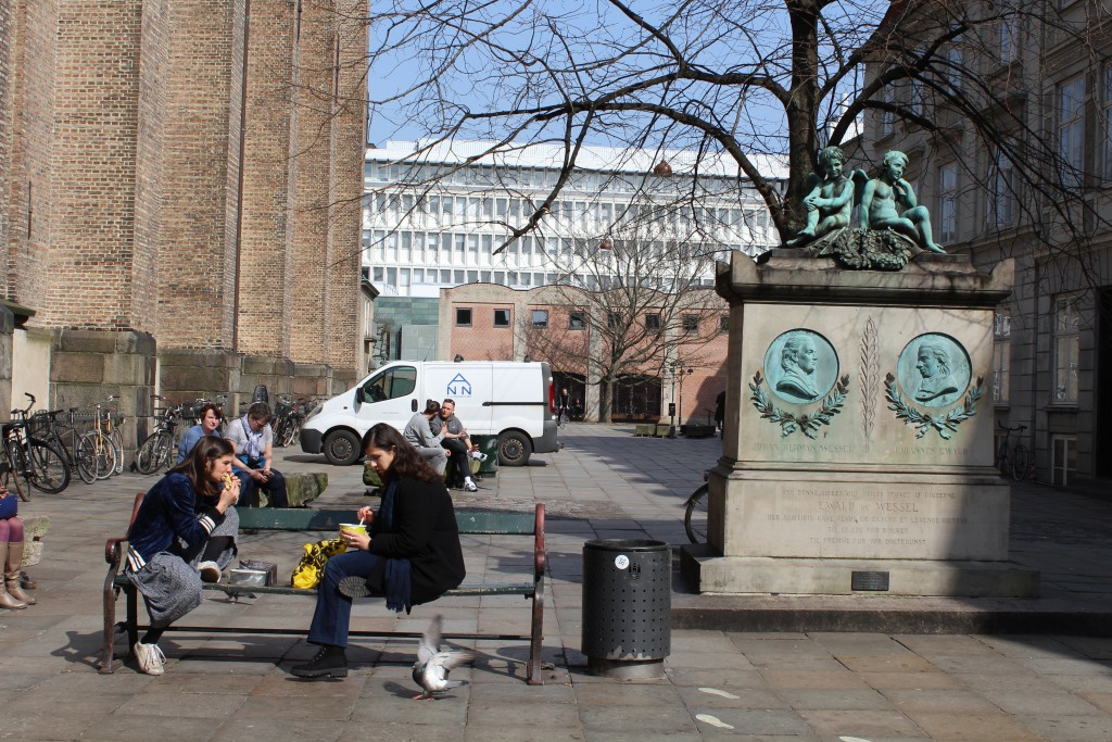 Square at Trinitatis Church and Rundetårn with memorial monument to 2 danish poets and writers.