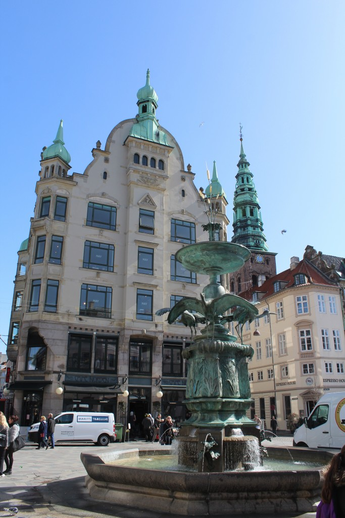 Amagertorv with Storkespringvandet built 1894 and tower of Sct. Nicolai Church. Phto