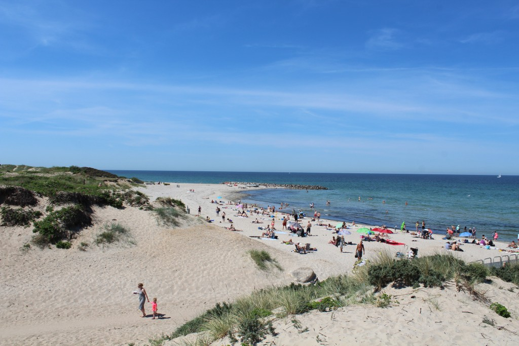 "Liseleje Beach. View to entrance raad (adgangsvej) to the beach. View in direction west til breakwater ""Pynten"" go big granite stones and Kattegat Sea. Photo 2. june 2018 12.50 pm by Erik K Abrahamsen"